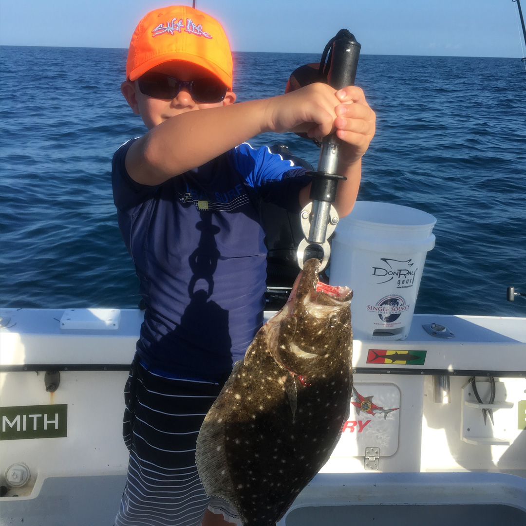 kid_with_flounder
