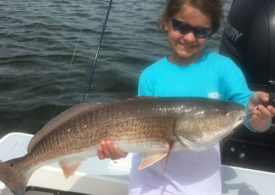 Kid with Inshore Redfish