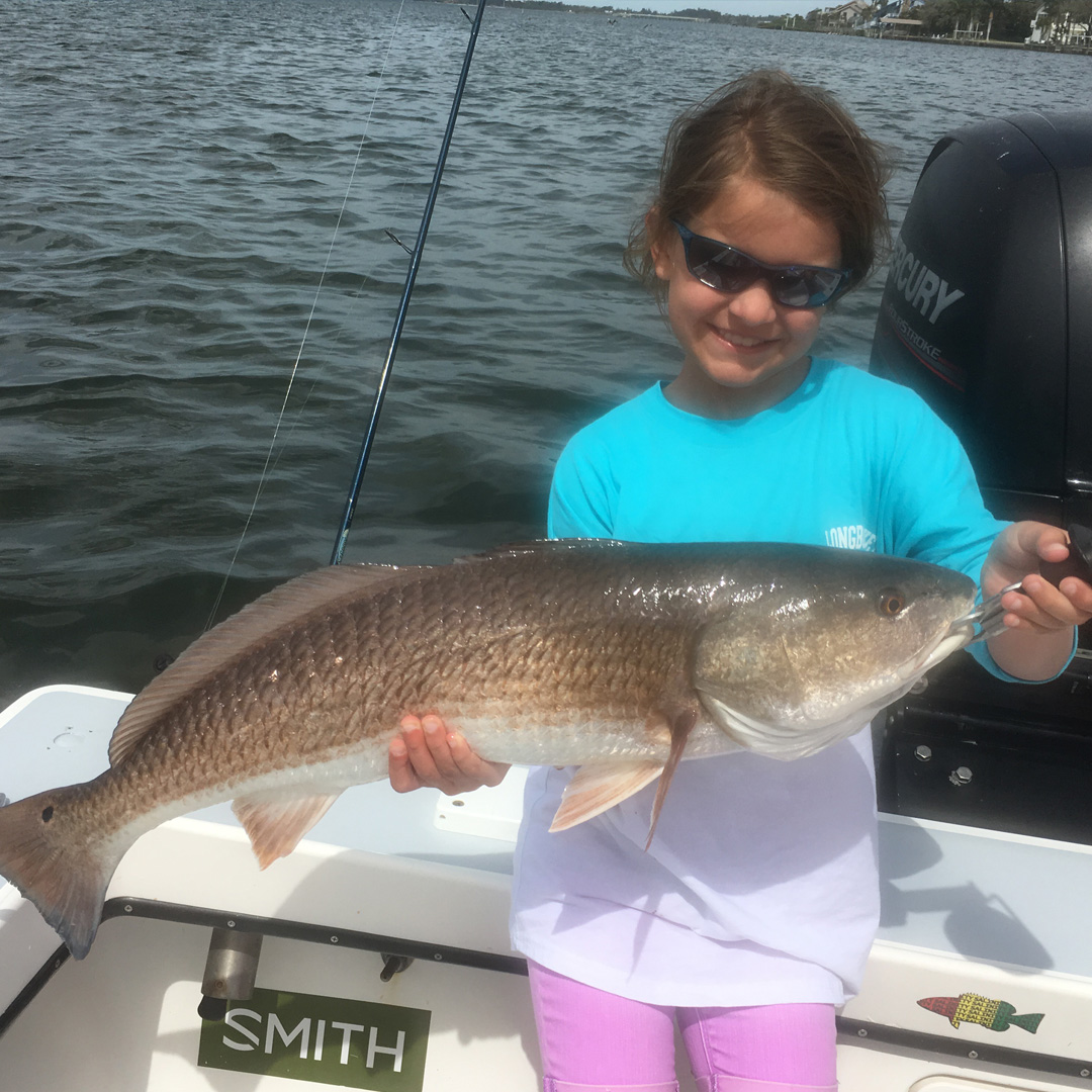 kid_grinning_with_redfish_winter