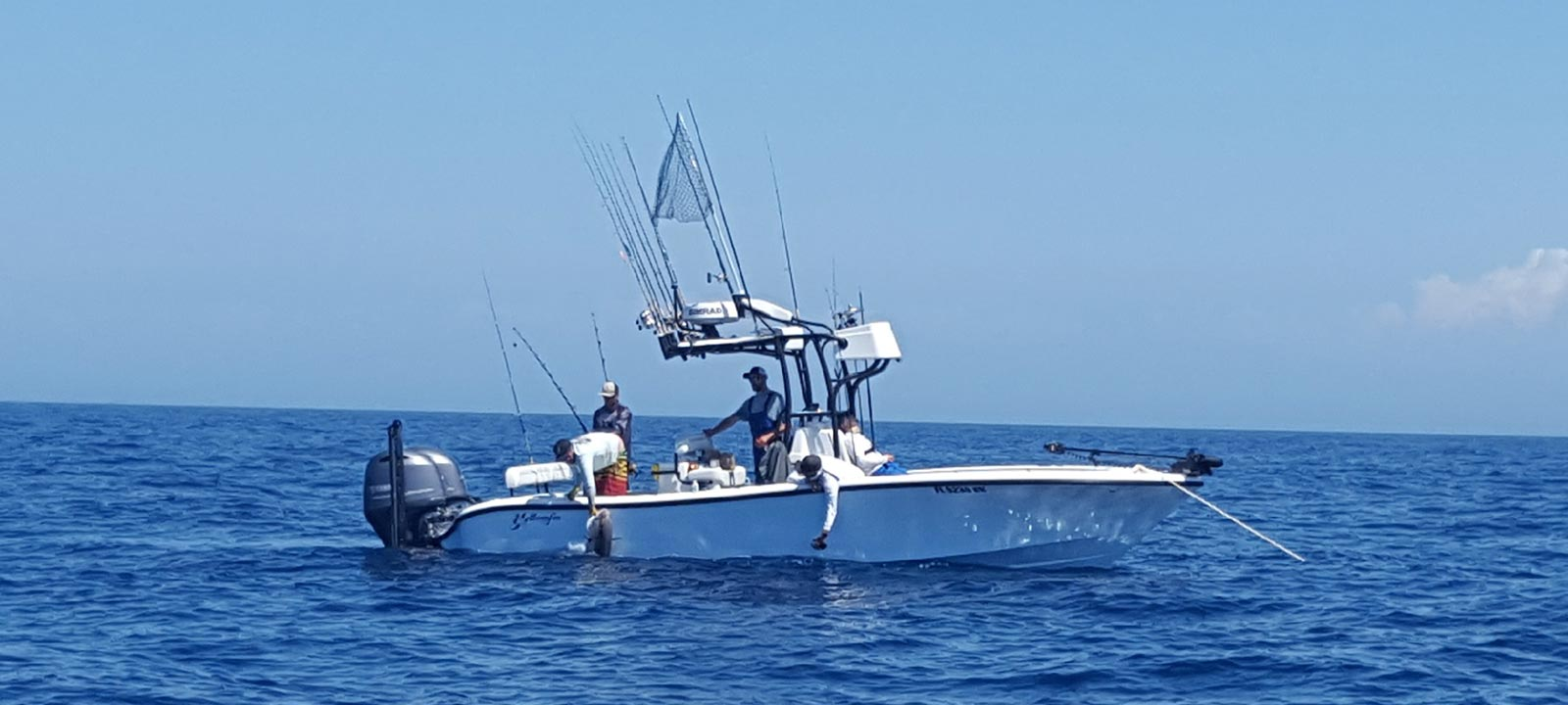 Great shot of the 26' Yellowfin in action as well pull up some blackfin tunas on an offshore fishing charter.