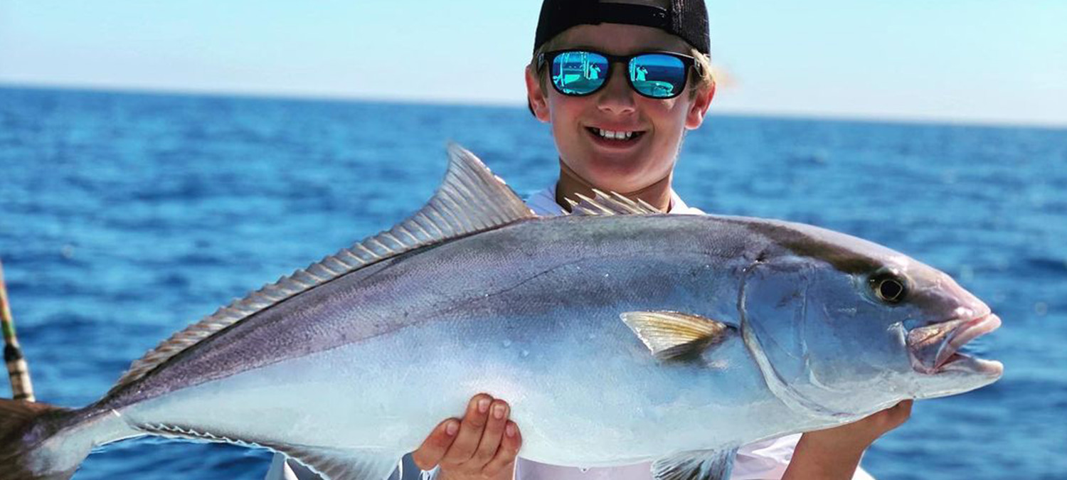 These kids are stoked to be fishing offshore on a charter.
